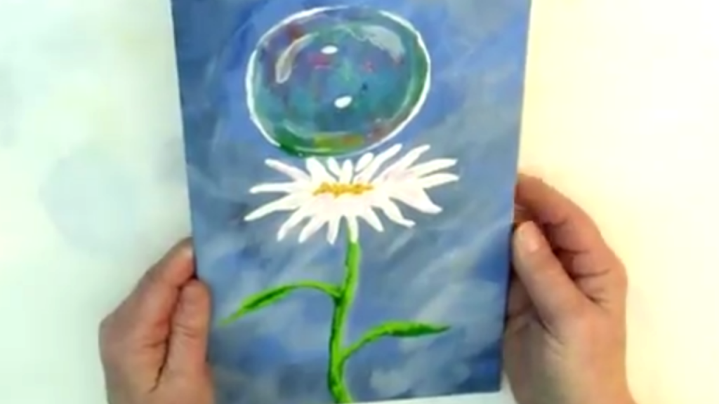 Shiny Soap bubble floating down to a single daisy