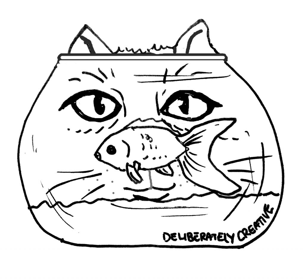 black and white cat and goldfish with bowl
