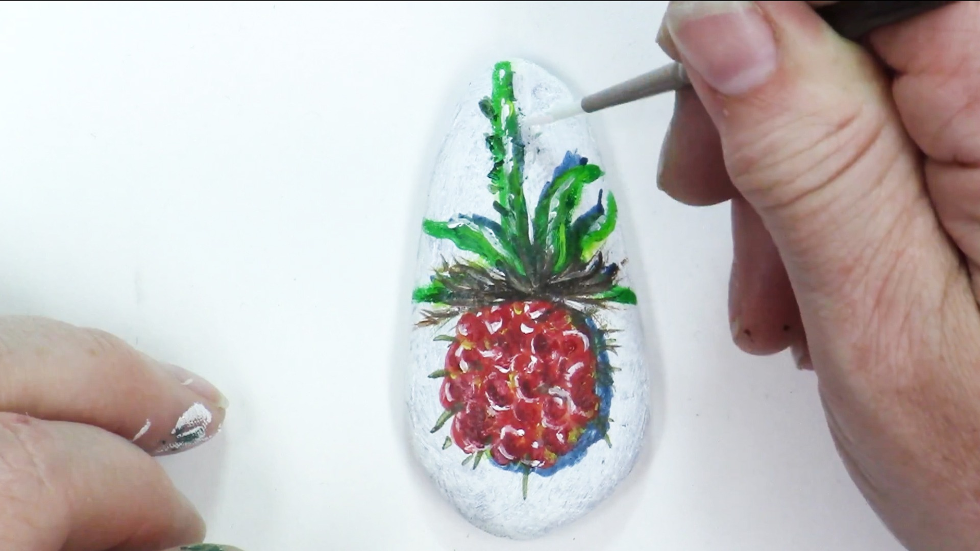 hand painted raspberry on a small stone