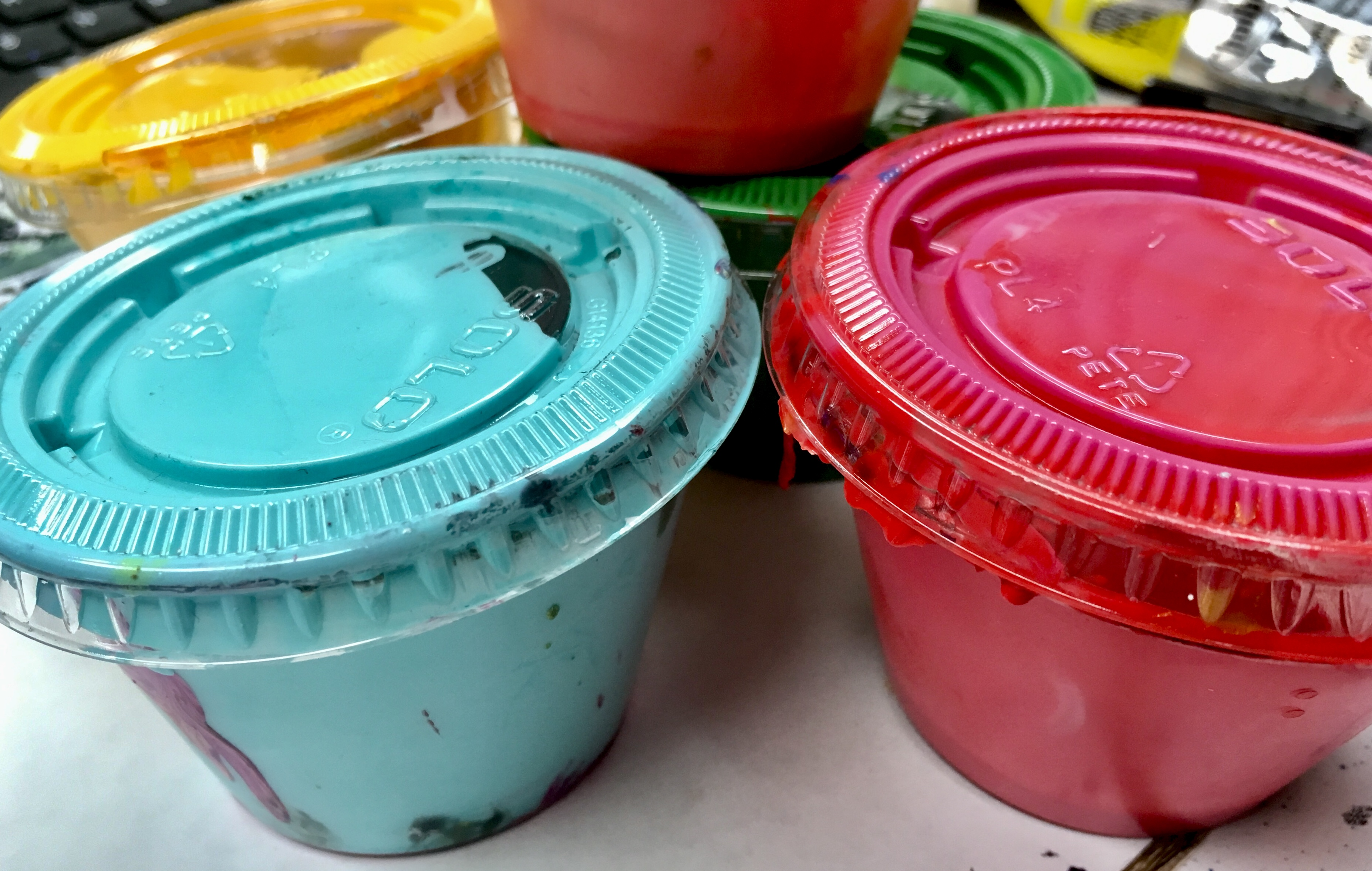cups of colored paint